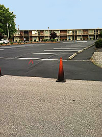 Striping a Newly Sealed Asphalt Parking Lot